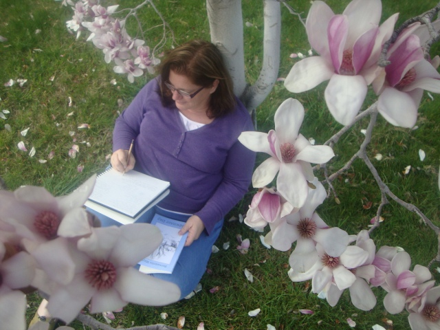 woman journaling in nature -