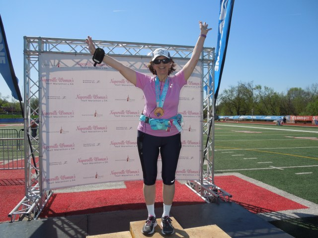 standing on the finisher's podium