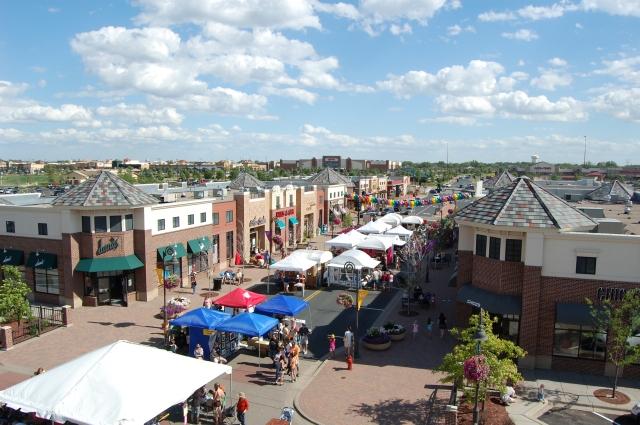 suburban downtown Maple_Grove_Main_Street_During_Annual_Art_Fair