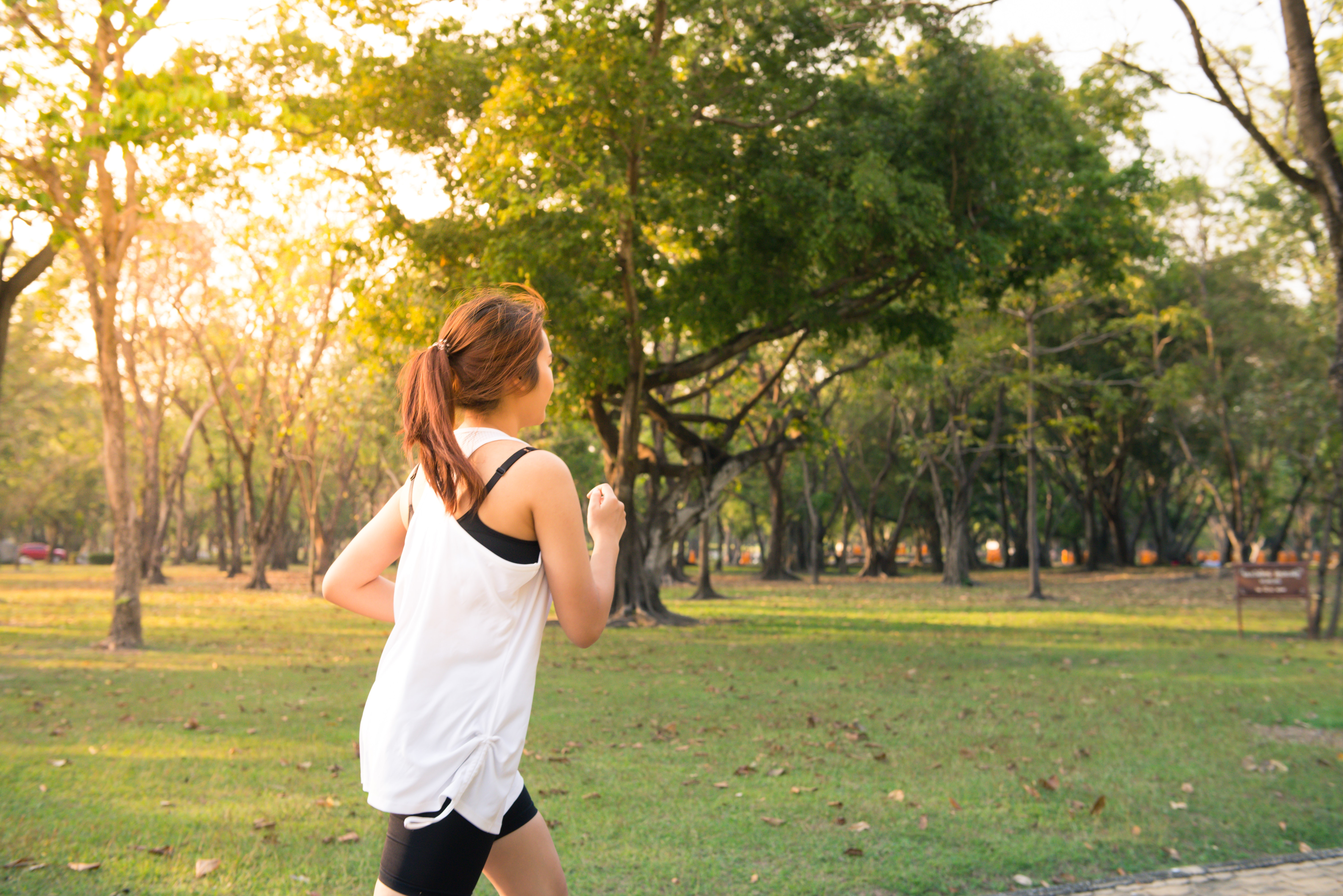woman running in forest preserve